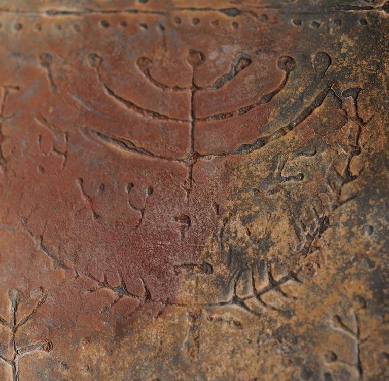 Representación de la menorá de siete brazos en uno de los códices