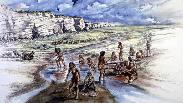 Representación artística de Boxgrove hace medio millón de años. Muestra a un grupo de humanos pre-neandertales, incluida una mujer que hace una herramienta de pedernal